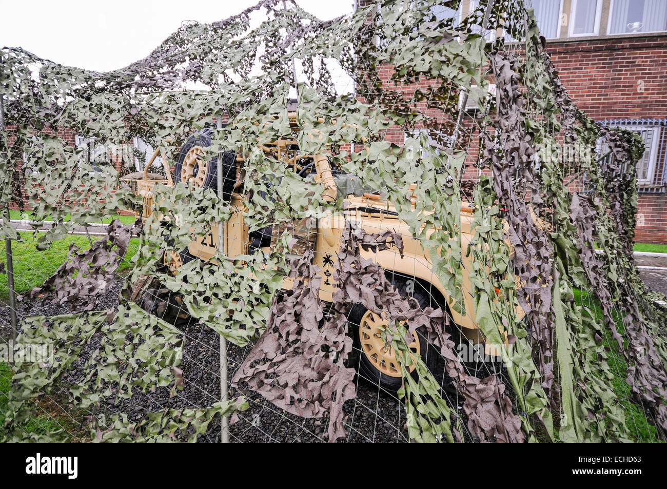 4.5T MWMIK (Mobility Weapon Mounted Installation Kit), also known as Wimiks, hidden by camouflage netting - Stock Image