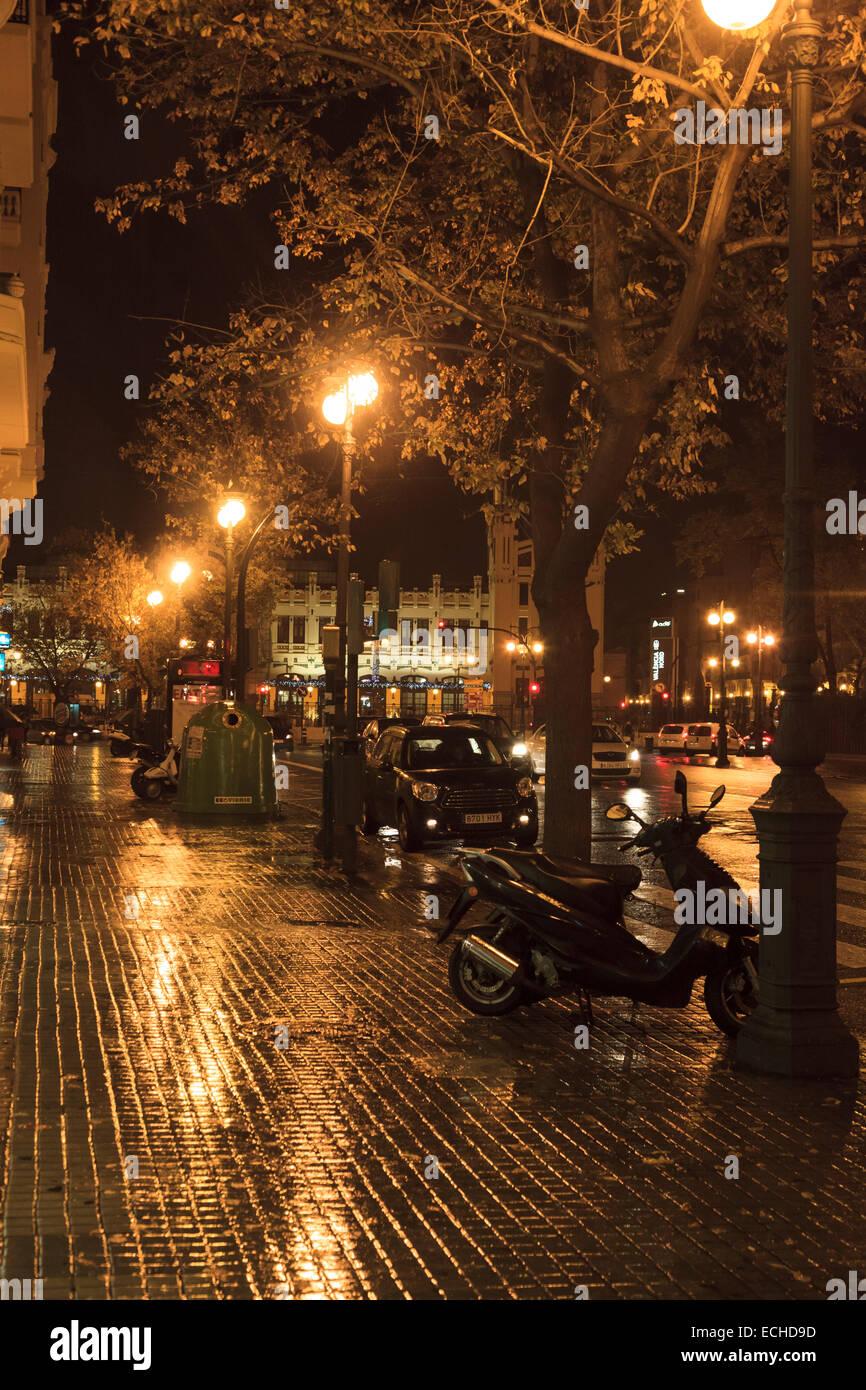 Wet And Rainy City Streets Of Valencia At Night With