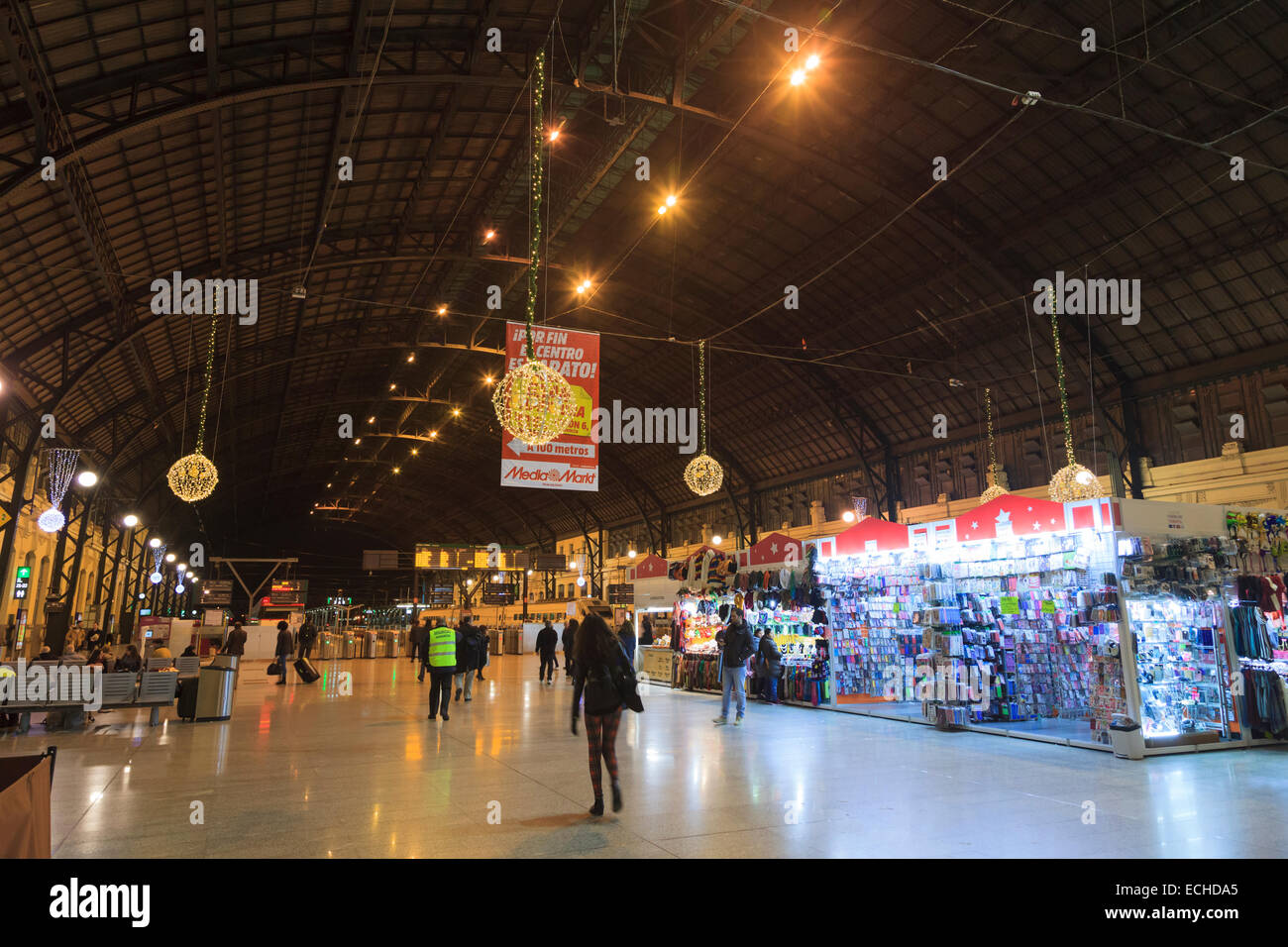 Concourse leading to platforms of the main railway station Estacio del Nord in Valencia Spain at night - Stock Image