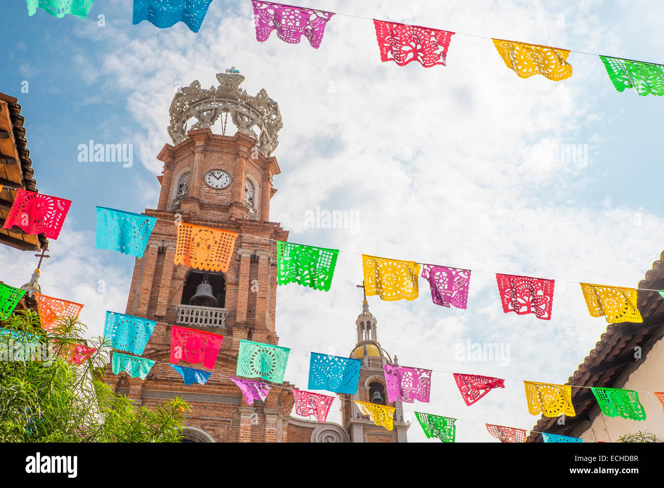 El Centro with Church of Our Lady of Guadalupe and colorful flag lines in front. Downtown Puerto Vallarta, Jalisco, - Stock Image