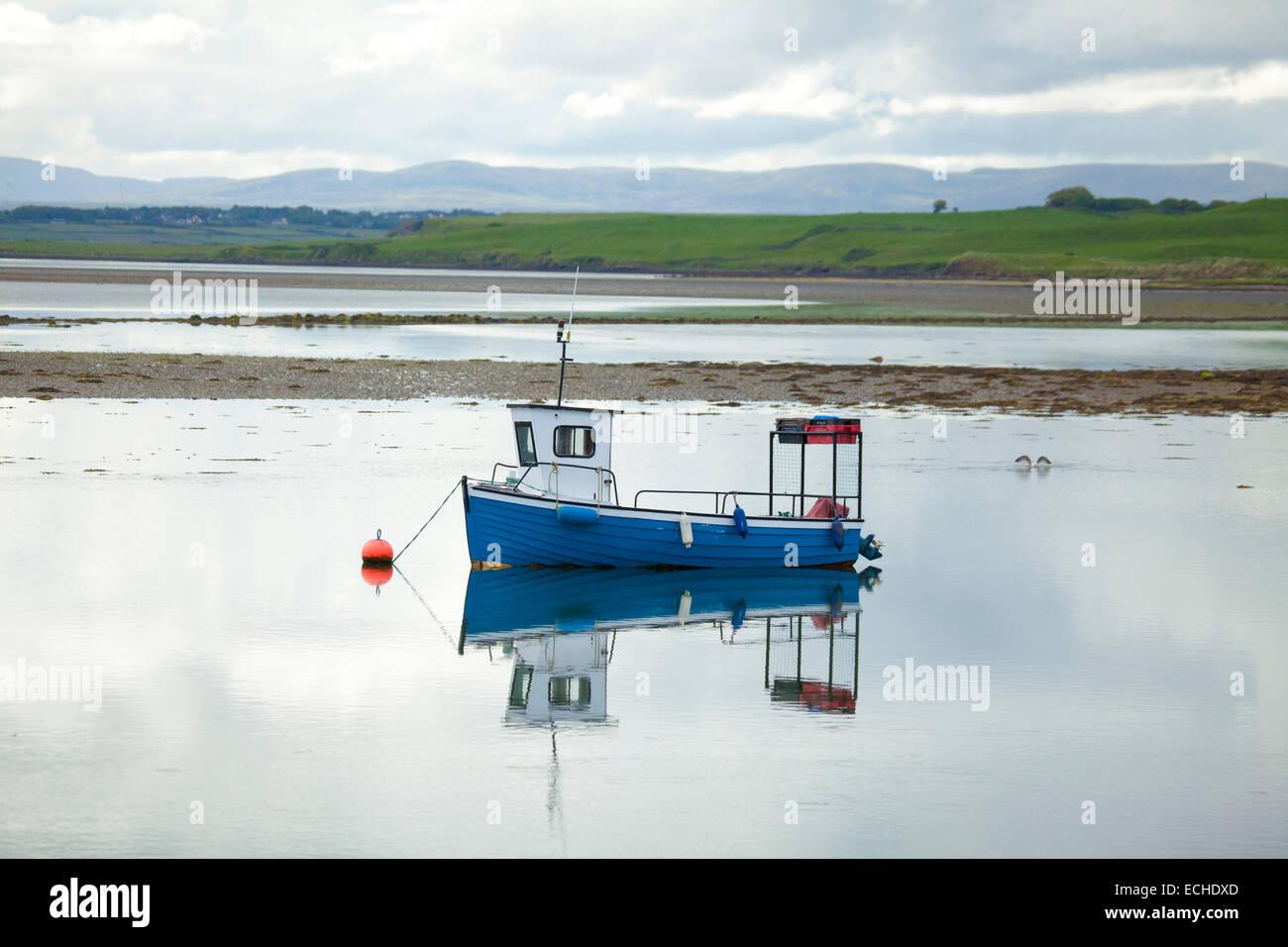 Reflection of lobster fishing boat moored in Killala Harbour. County Mayo, Ireland. - Stock Image