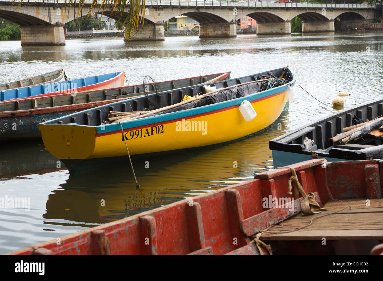 Mauritius, Mahebourg, fishing boats moored on banks of Riviere La Chaux River - Stock Image