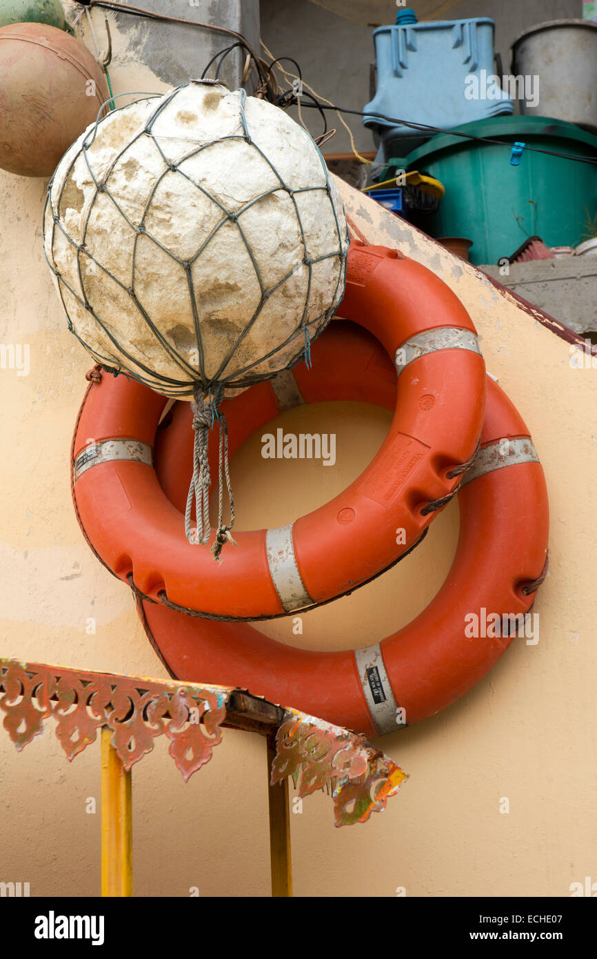 Mauritius, Mahebourg, lifebelts and fishing buoy on banks of Riviere La Chaux River - Stock Image