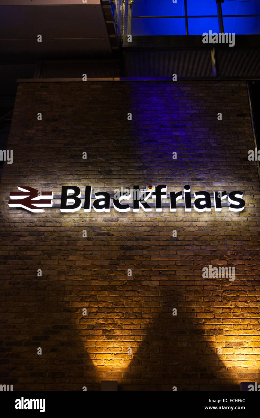 Blackfriars station sign lit attached to a brick wall, London, UK - Stock Image
