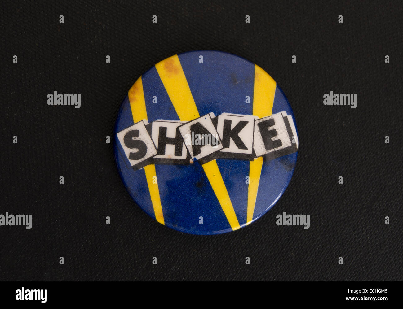 lapel badge promoting short lived late 1970s band, shake - Stock Image