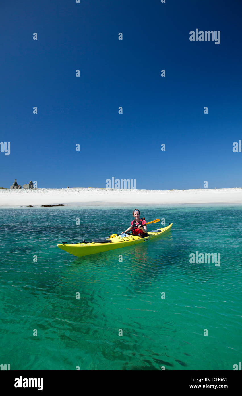 Sea kayaking beside Inishkea South Island, County Mayo, Ireland. - Stock Image