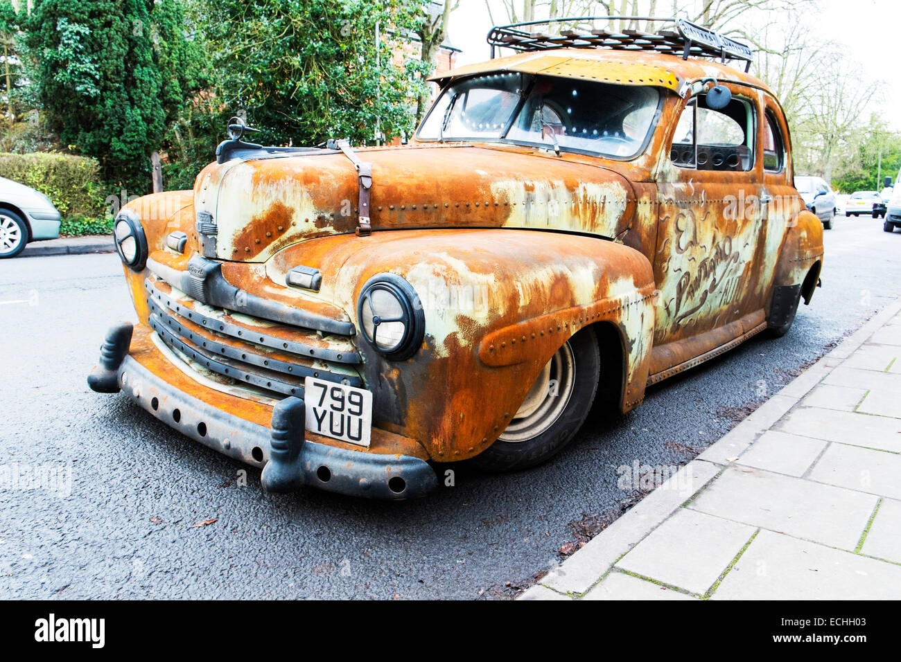 Ford super deluxe 8 V8 old  rusty car wreck 1947 classic parked rust rusted pitted unkempt unloved uncared for not Stock Photo