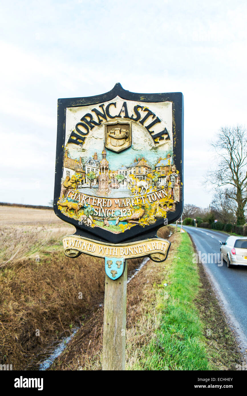 Horncastle Lincolnshire village sign board welcome to road rural twinned with - Stock Image