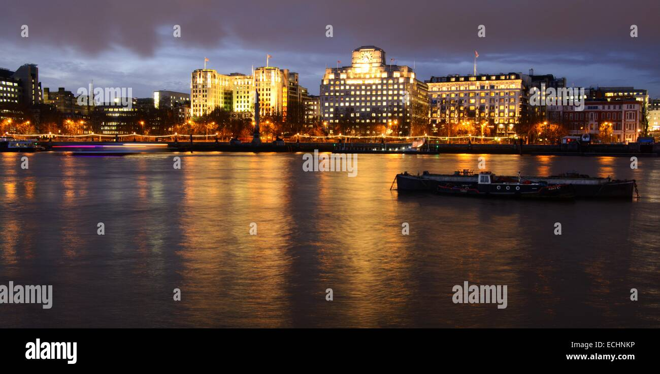 View of Victoria Embankment in London, England at dusk - Stock Image
