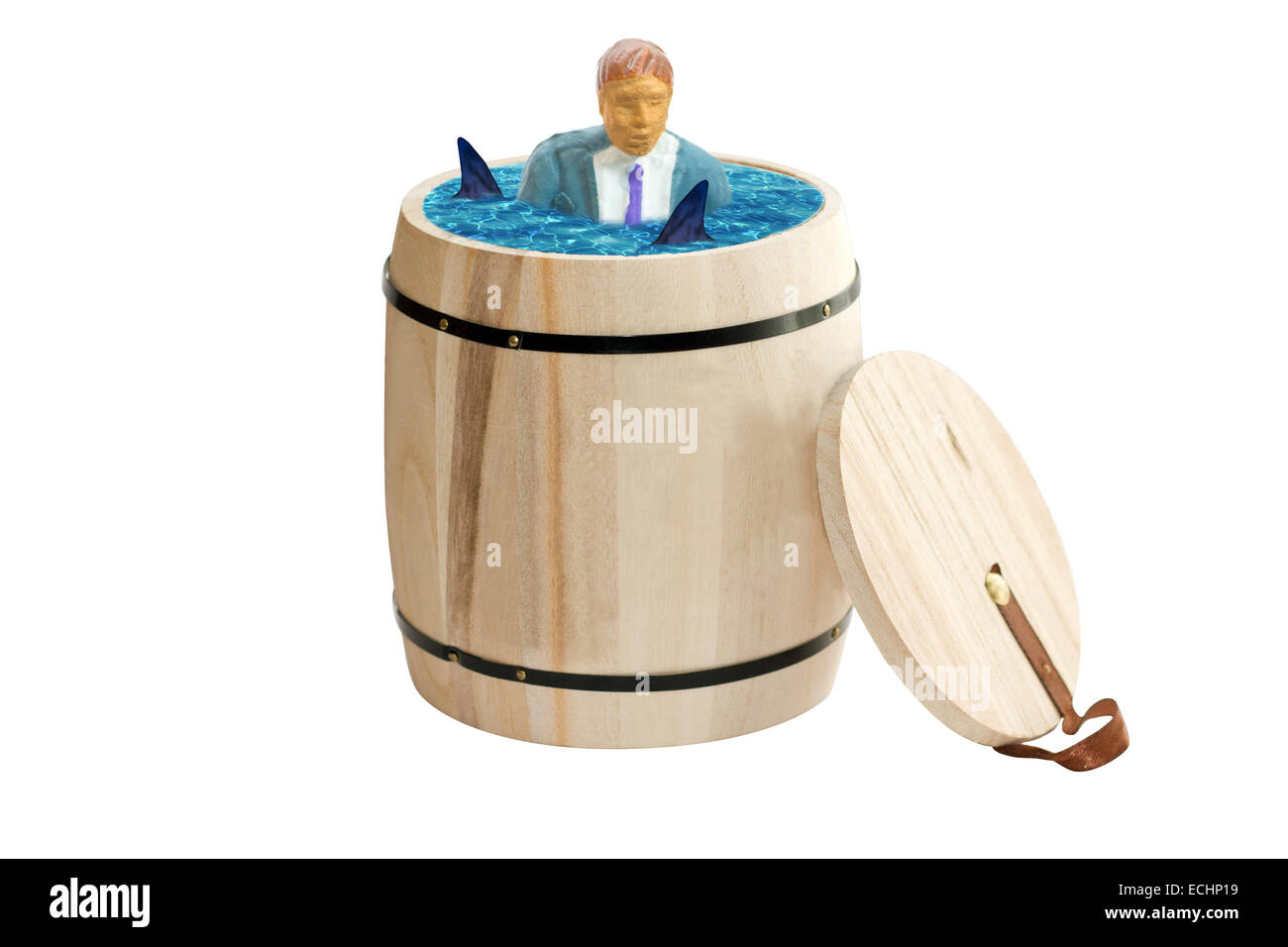 businessman standing in water with sharks Stock Photo