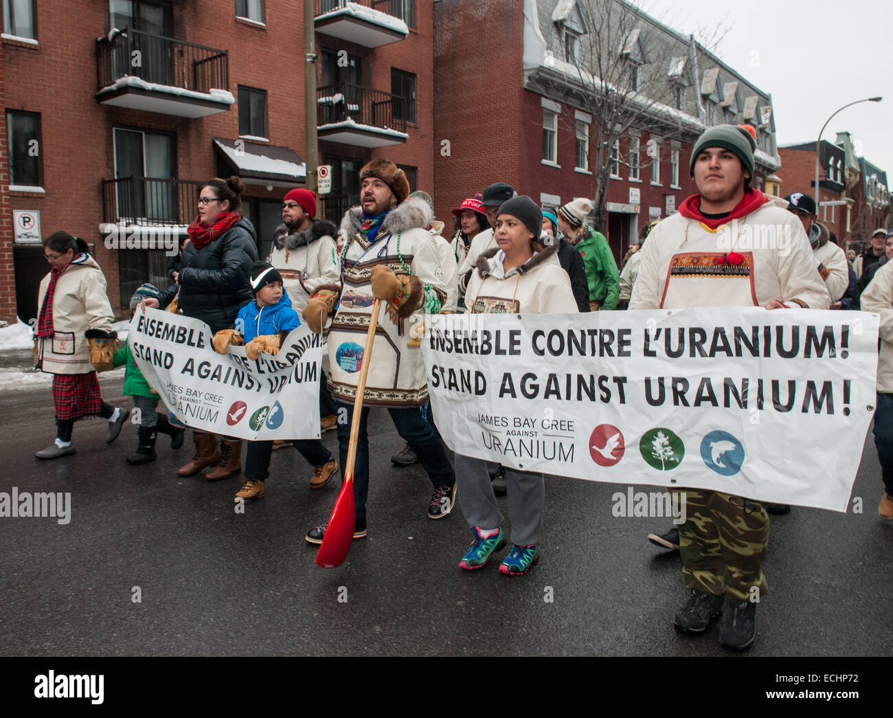 Montreal, Canada. 15th Dec, 2014. Native Cree walkers against uranium development in their region arrive to the - Stock Image