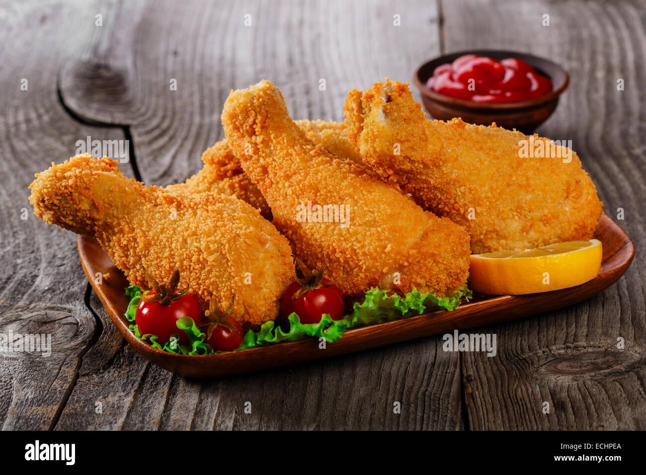 fried chicken legs breaded Stock Photo