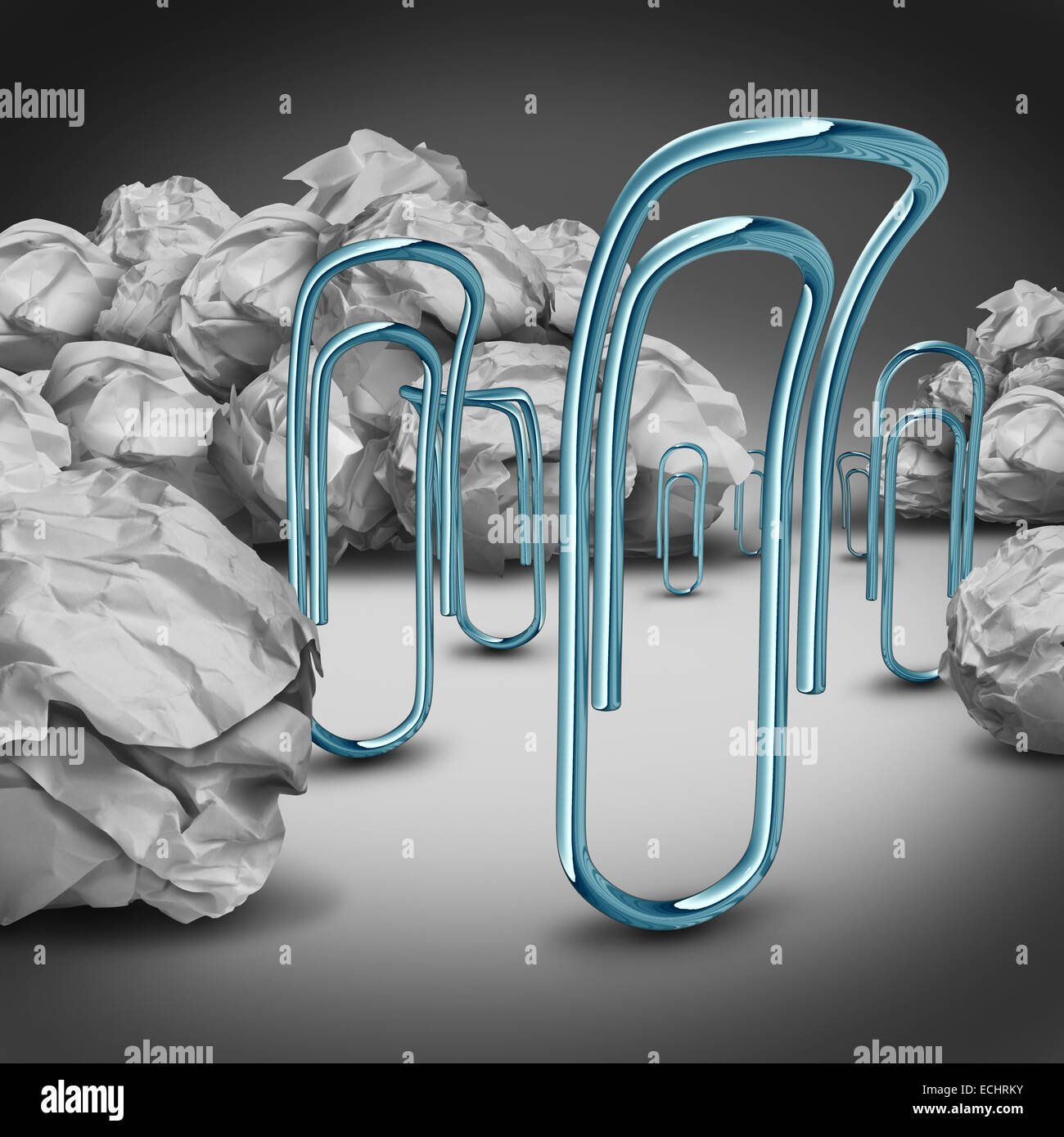 Office downsizing concept as a group of sad depressed paper clips moving away from crumpled paper as a symbol and - Stock Image