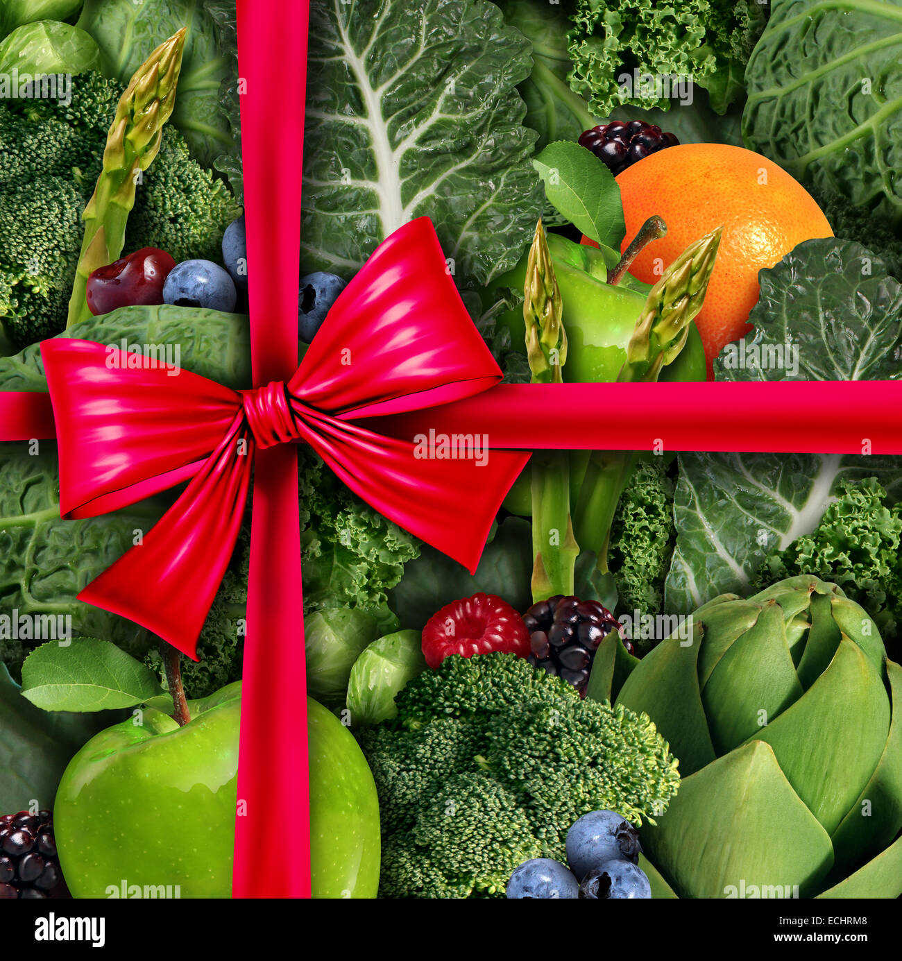 Healthy food gift concept as a group of fresh fruit and vegetables with a red silk bow  packaging ribbon as a diet - Stock Image