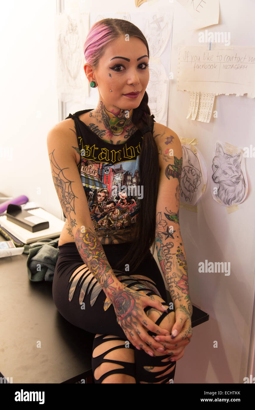 ISTANBUL, TURKEY - SEPTEMBER 20, 2014: Tattooists girl in Istanbul Tattoo Convention which held in Kadikoy. Stock Photo