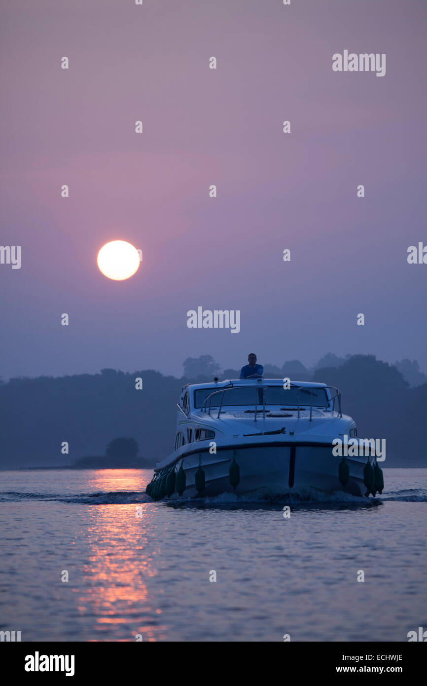 Cruise boat crossing Lough Ree at dawn, River Shannon, County Westmeath, Ireland. - Stock Image