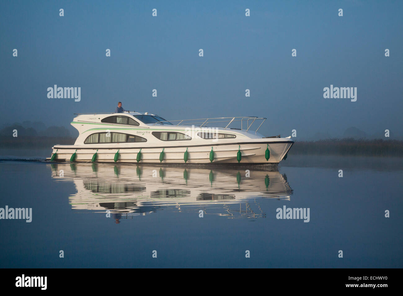 Reflection of a cruise boat crossing Lough Ree, River Shannon, County Westmeath, Ireland. Stock Photo