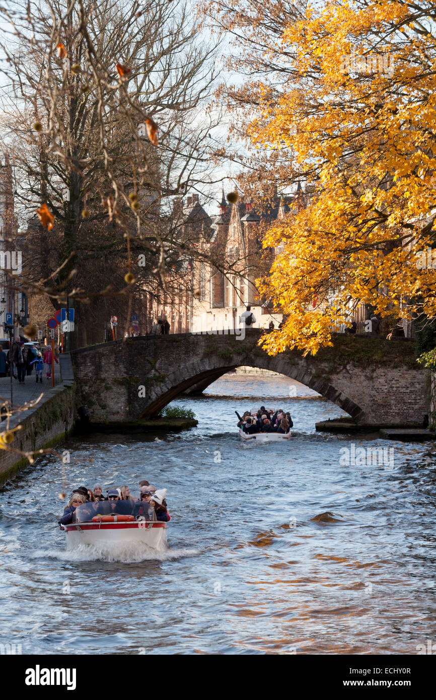 Tourists on boat trips on the canal, Belgium in the autumn; Bruges, Belgium, Europe - Stock Image