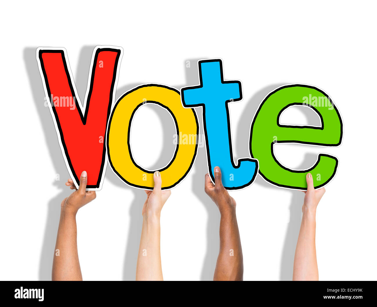 Diverse Hands Holding the Word Vote Stock Photo