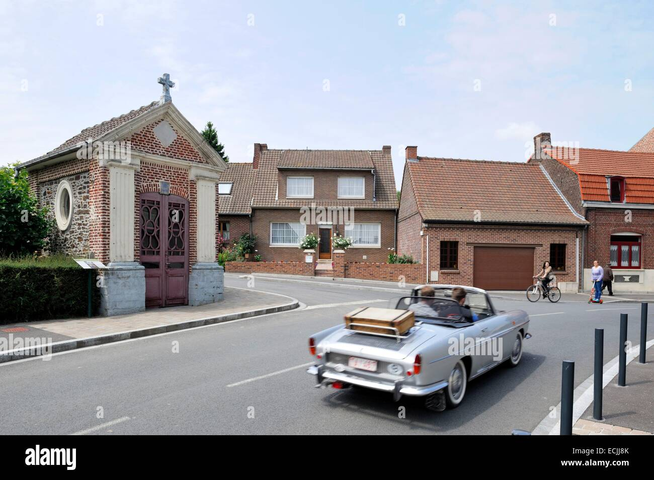 France, Nord, Boeschepe, Chapel of the Immaculate Conception, convertible and gray Belgian car passing the chapel - Stock Image
