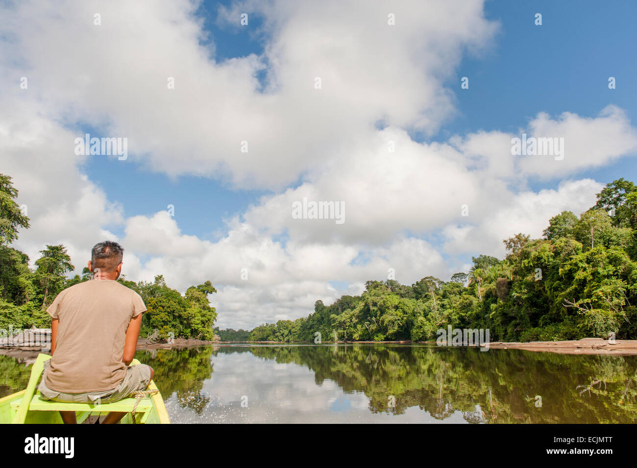 Tourguide Marcel travelling the Upper Suriname River in a traditional canoe, Suriname - Stock Image