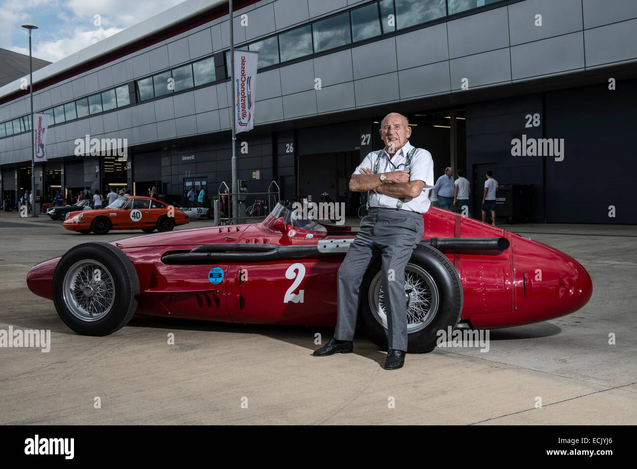 Stirling Moss poses with a Maserati 250F at Silverstone UK - Stock Image