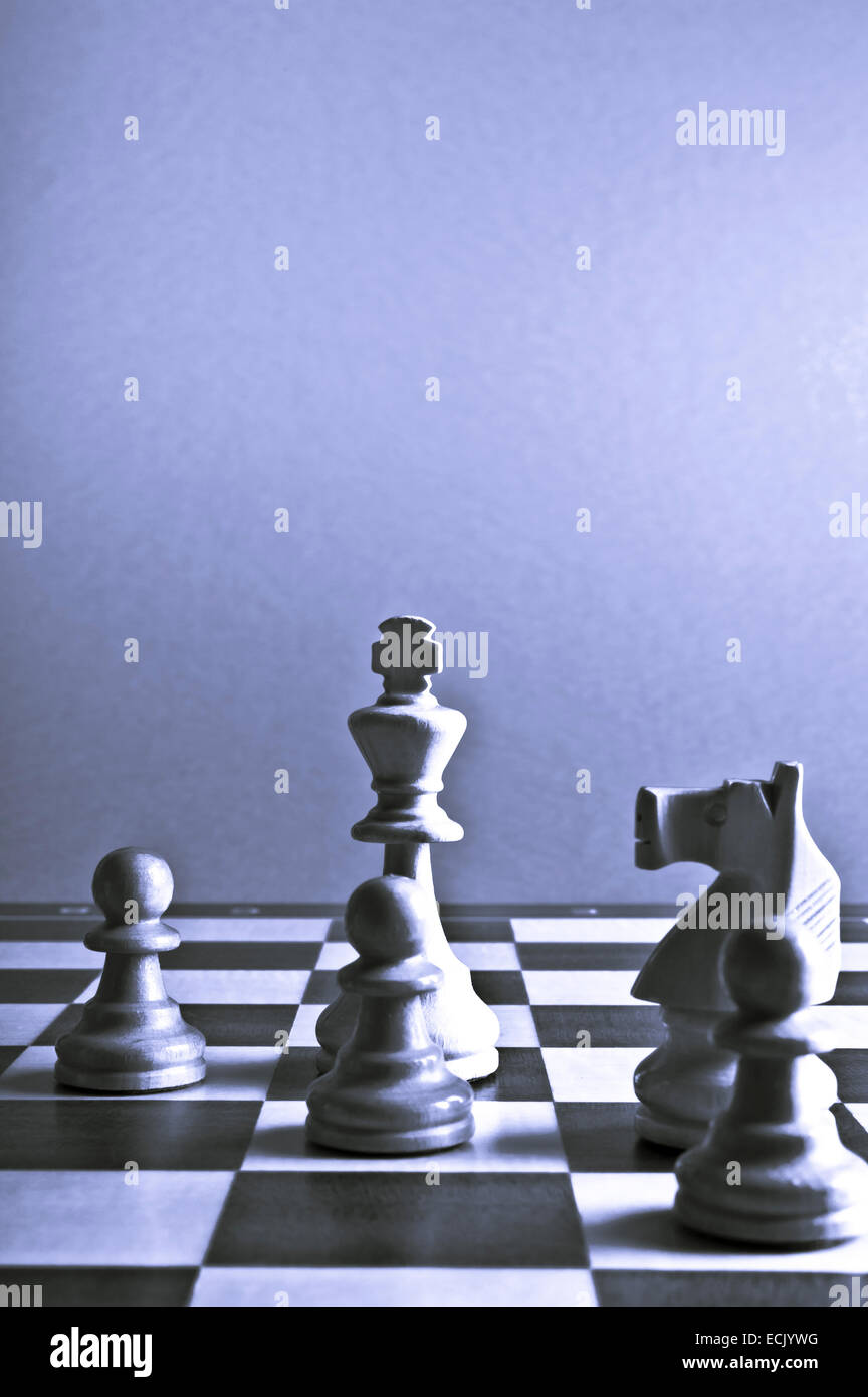 chess pieces on the chessboard - Stock Image