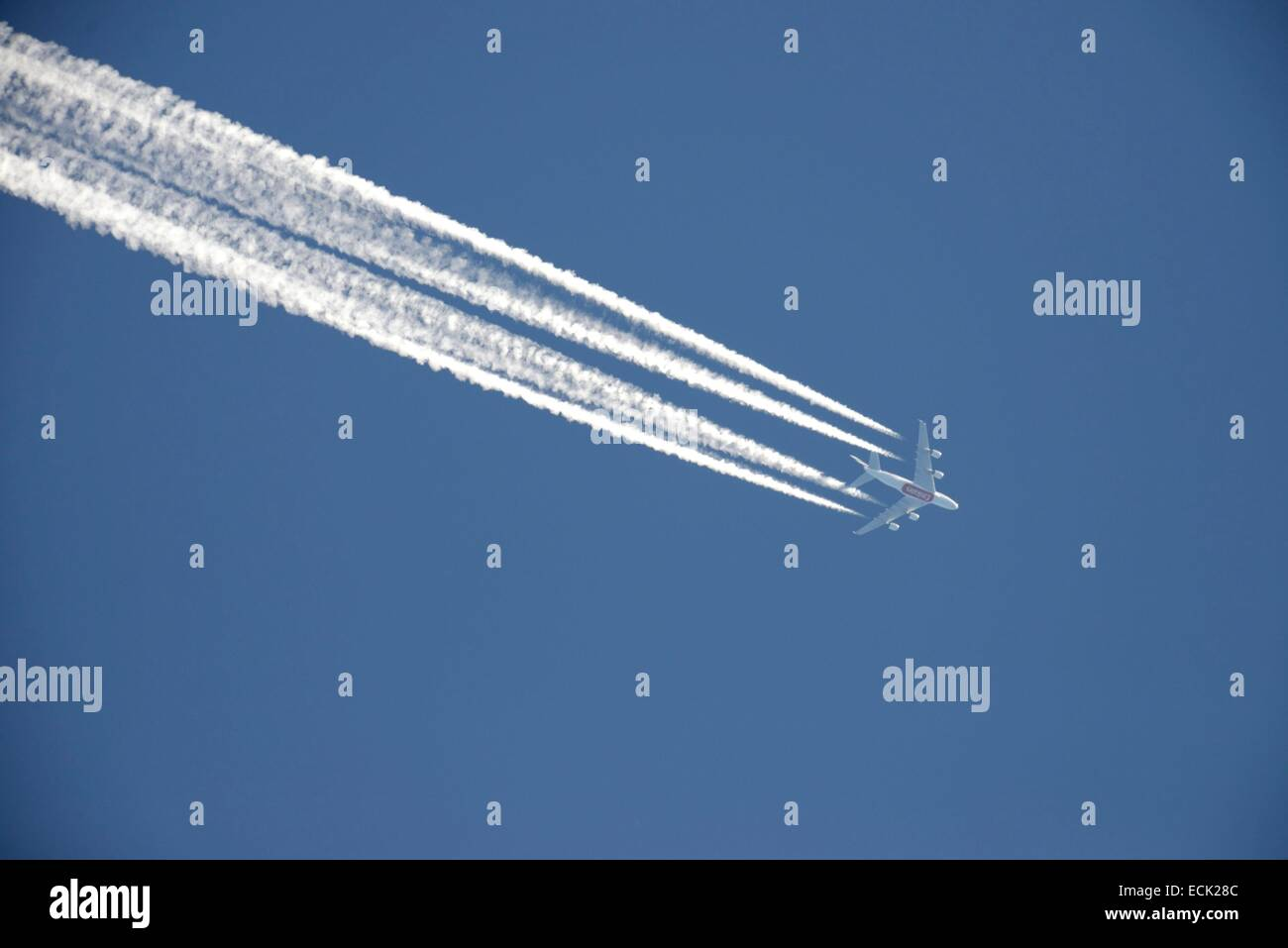 France, Doubs, long haul aircraft with four engines in the open blue sky leaving a white trail behind him important - Stock Image