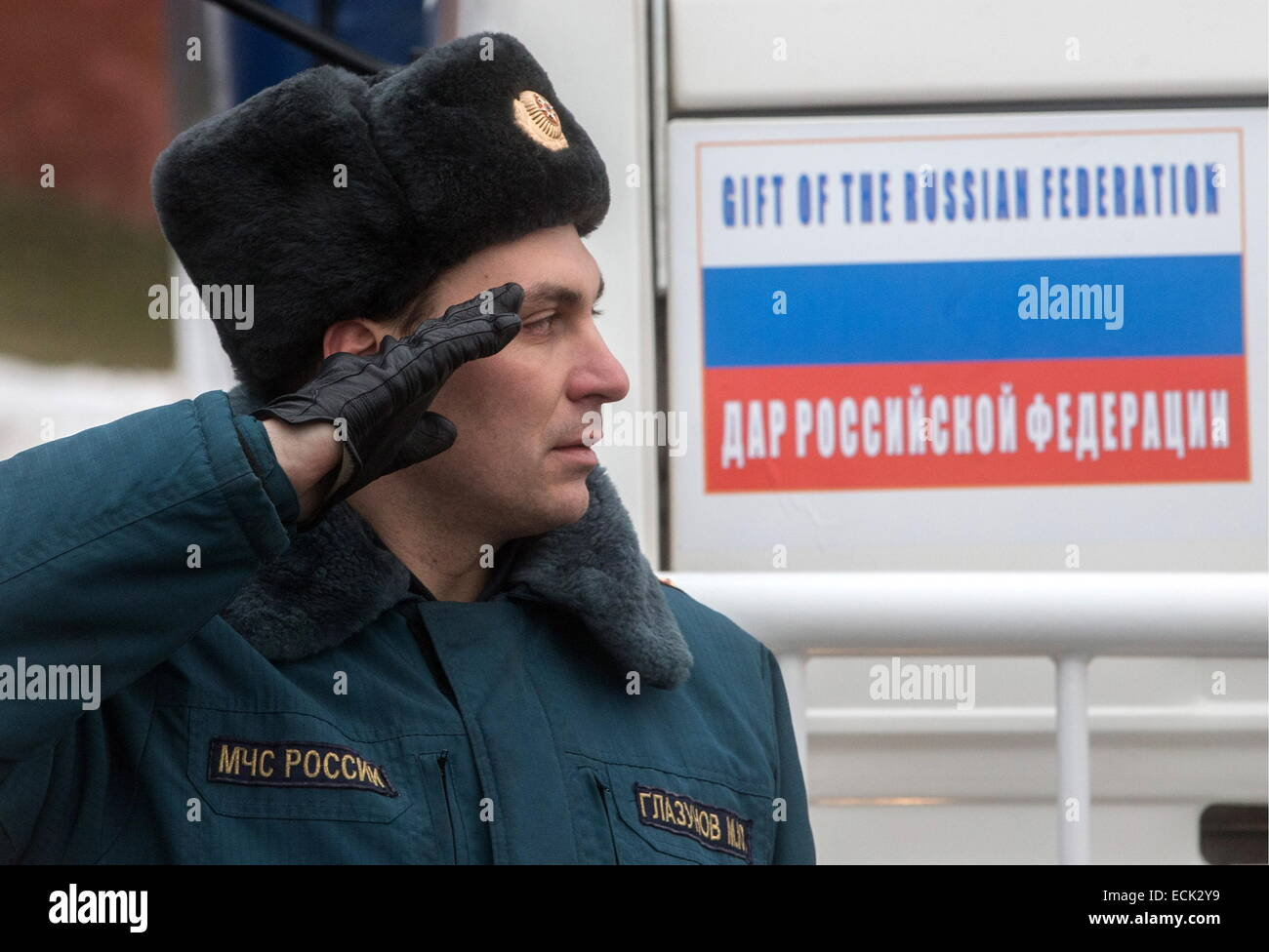 Moscow, Russia. 16th Dec, 2014. Russia's emergency situations ministry officer gives a salute during a KAMAZ trucks Stock Photo