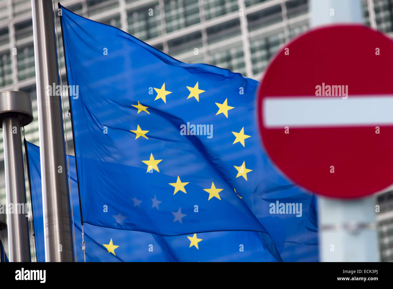 Russia sanctions. 'No entry' sign in front of European comission flags. - Stock Image