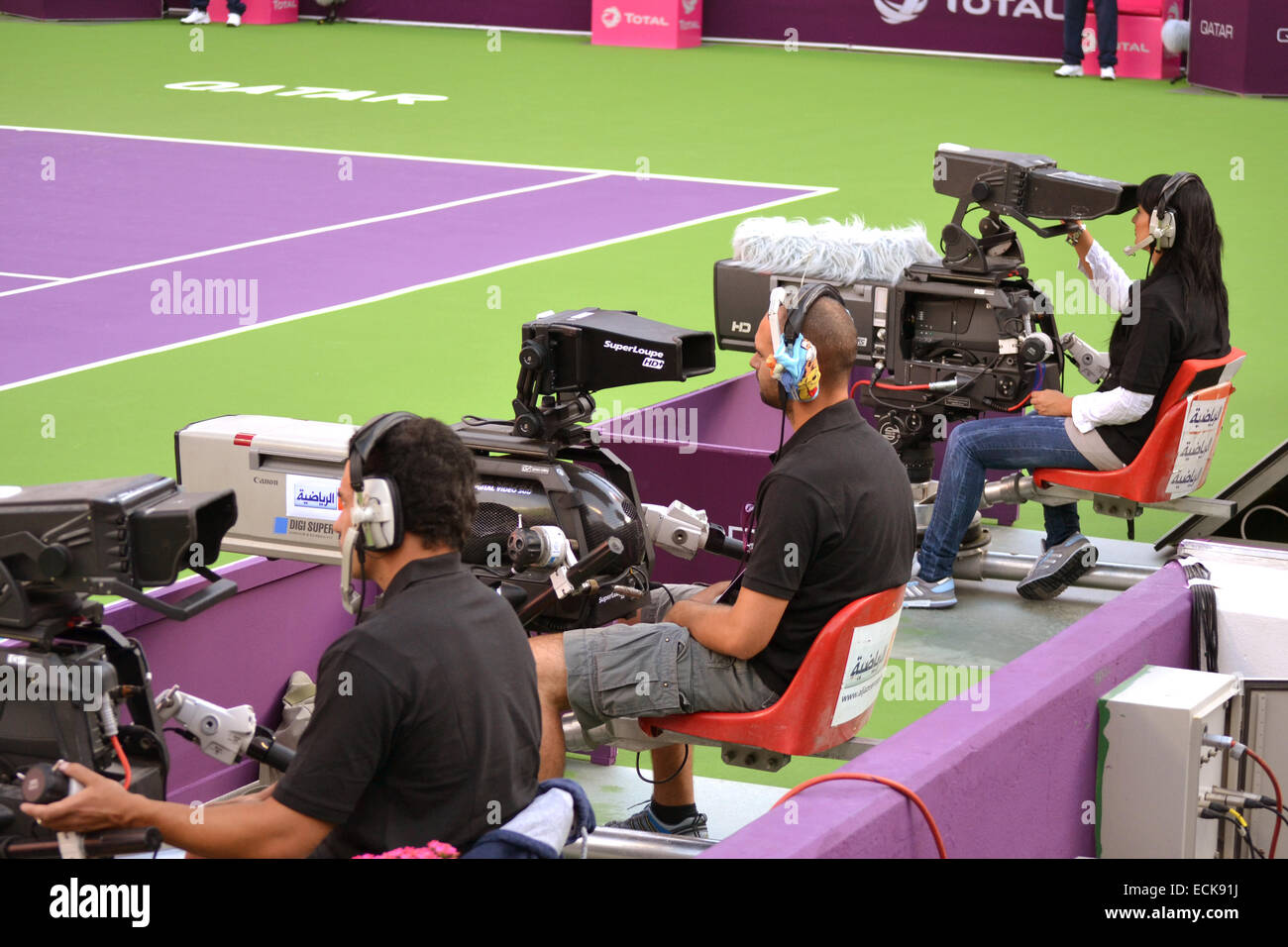 Aljazeera Sports Cameramen covering live Qatar Total Open on February 11, 2013 in Doha, Qatar. - Stock Image