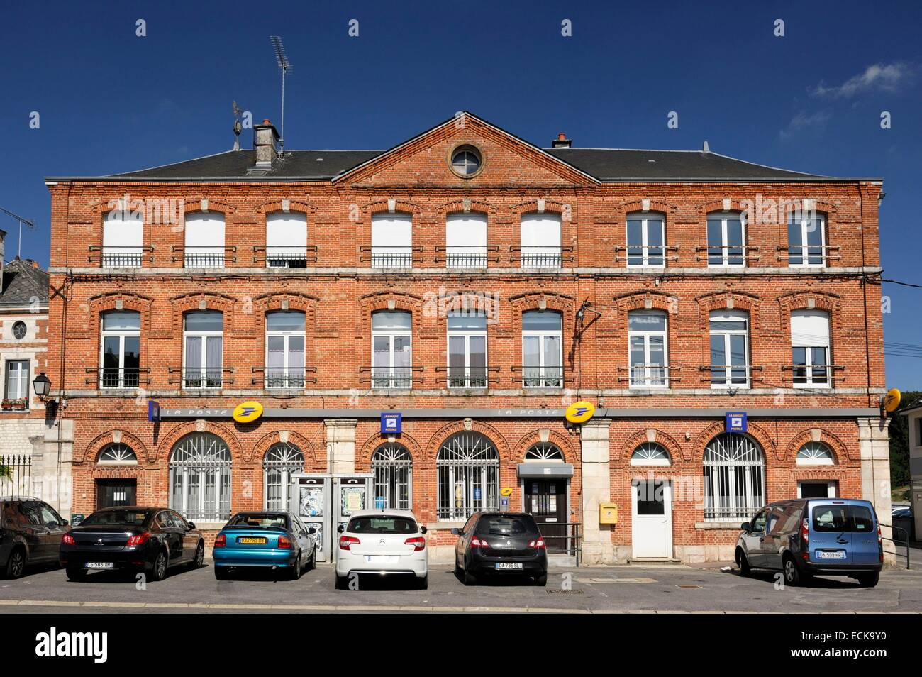 France, Ardennes, Signy l'Abbaye, cars parked in front of the post office - Stock Image