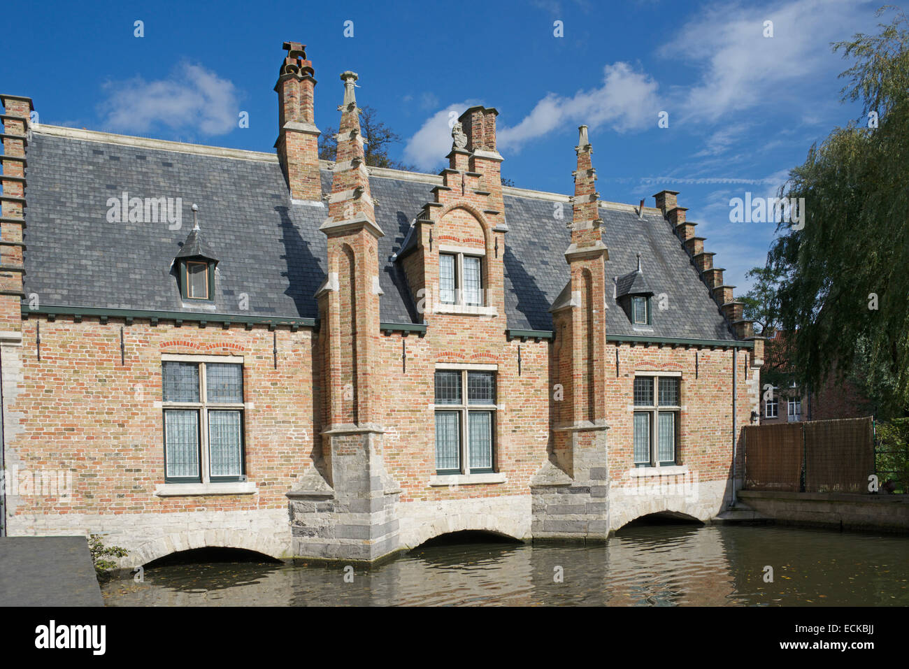 Gabled lock keeper house or sluice house Minnewater Bruges Belgium - Stock Image