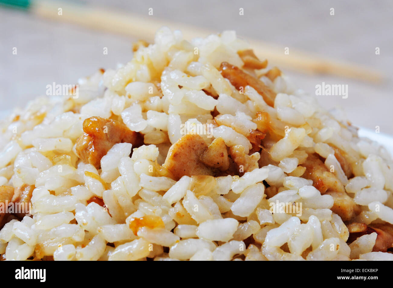 closeup of a plate with chicken fried rice - Stock Image