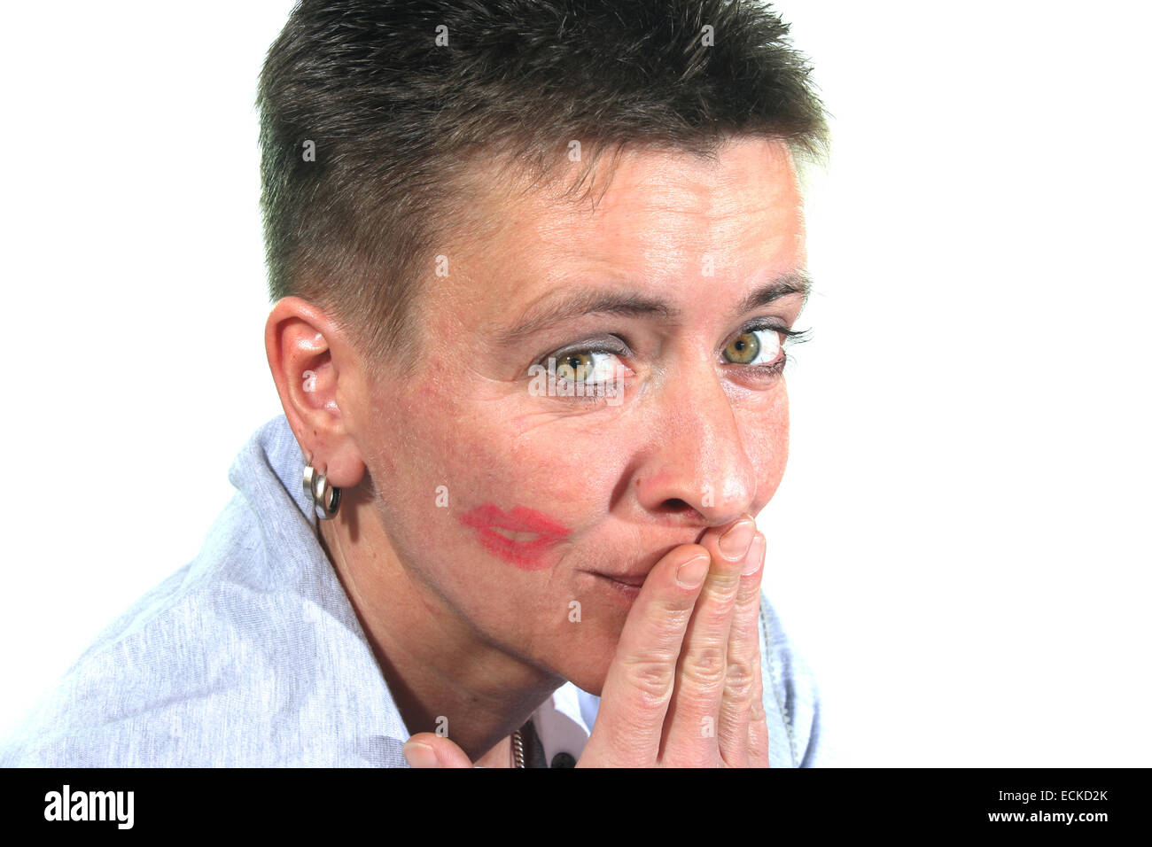 a young Woman embarrassed after a kiss - Stock Image