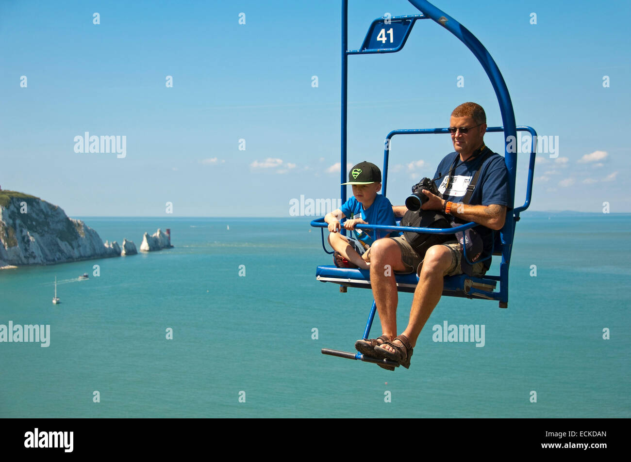 Charmant Horizontal View Of A Father And Son On The Chairlift At The Needles In The  Isle Of Wight.