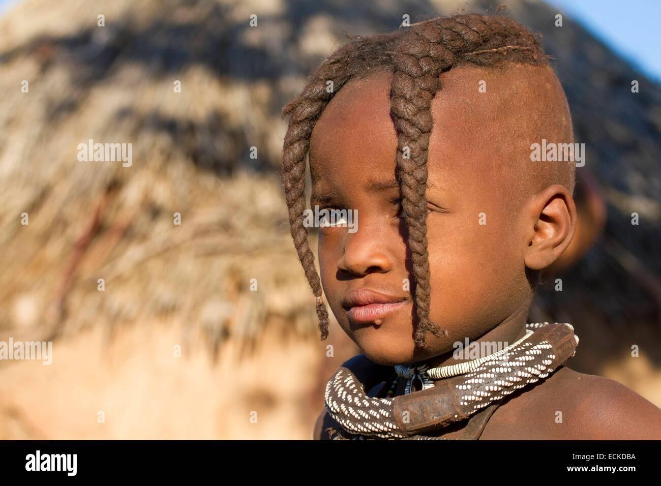 Namibia, Kunene region, Kaokoland, Himba village near Opuwo, Himba girl Stock Photo
