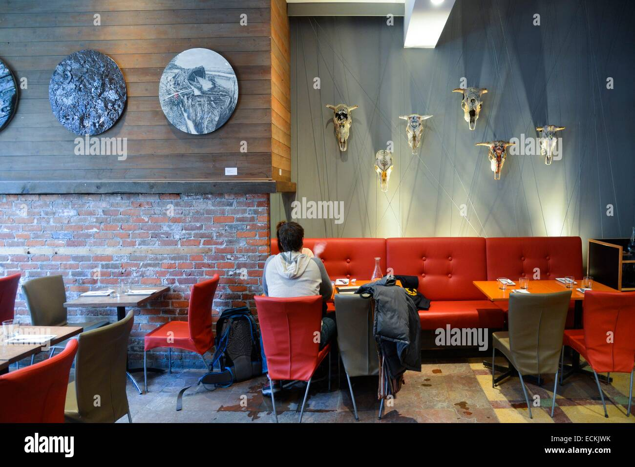 Canada, Quebec province, City of Quebec, restaurant of cultural Complex The Circle, man of back sat at a table - Stock Image
