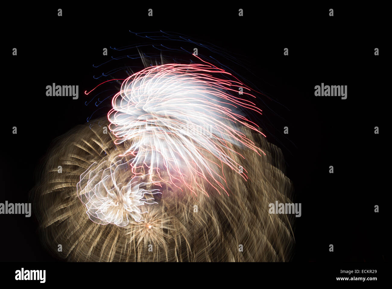 Firework display with blurred motion - Stock Image