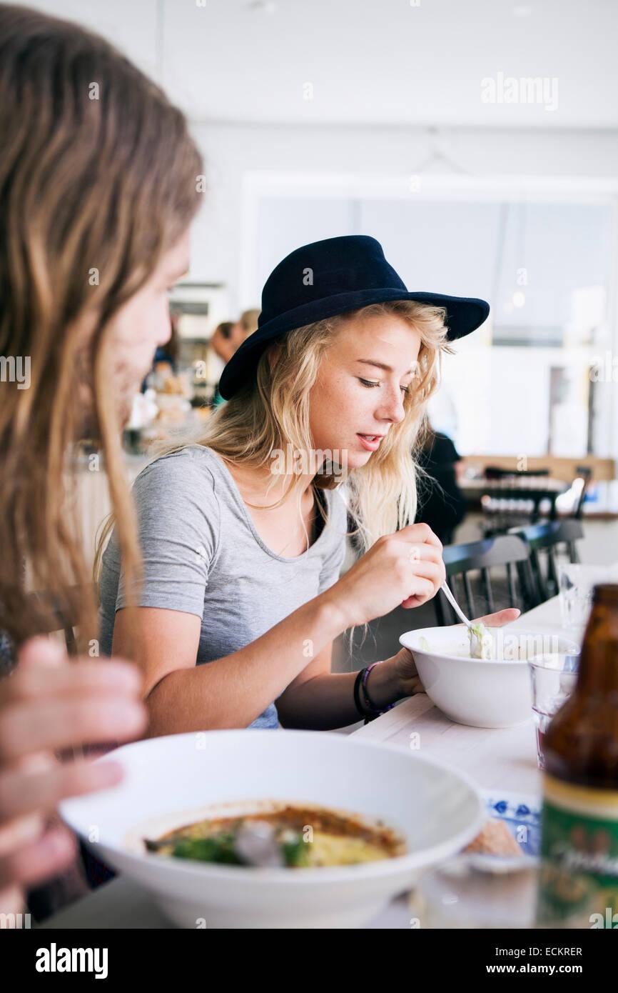 Couple having food in restaurant - Stock Image