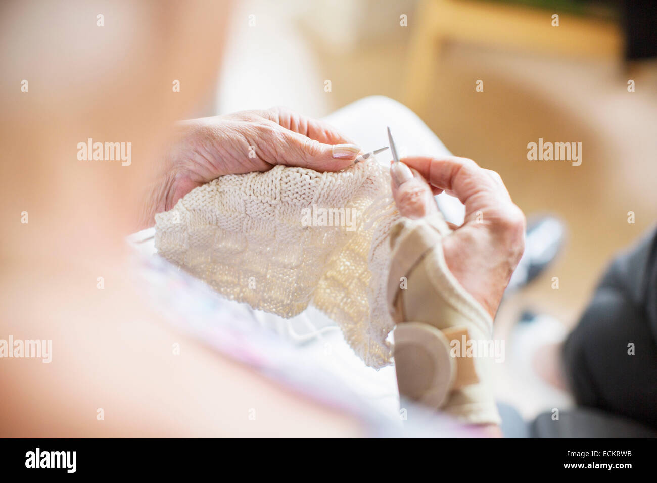 Cropped image of senior woman knitting at nursing home - Stock Image