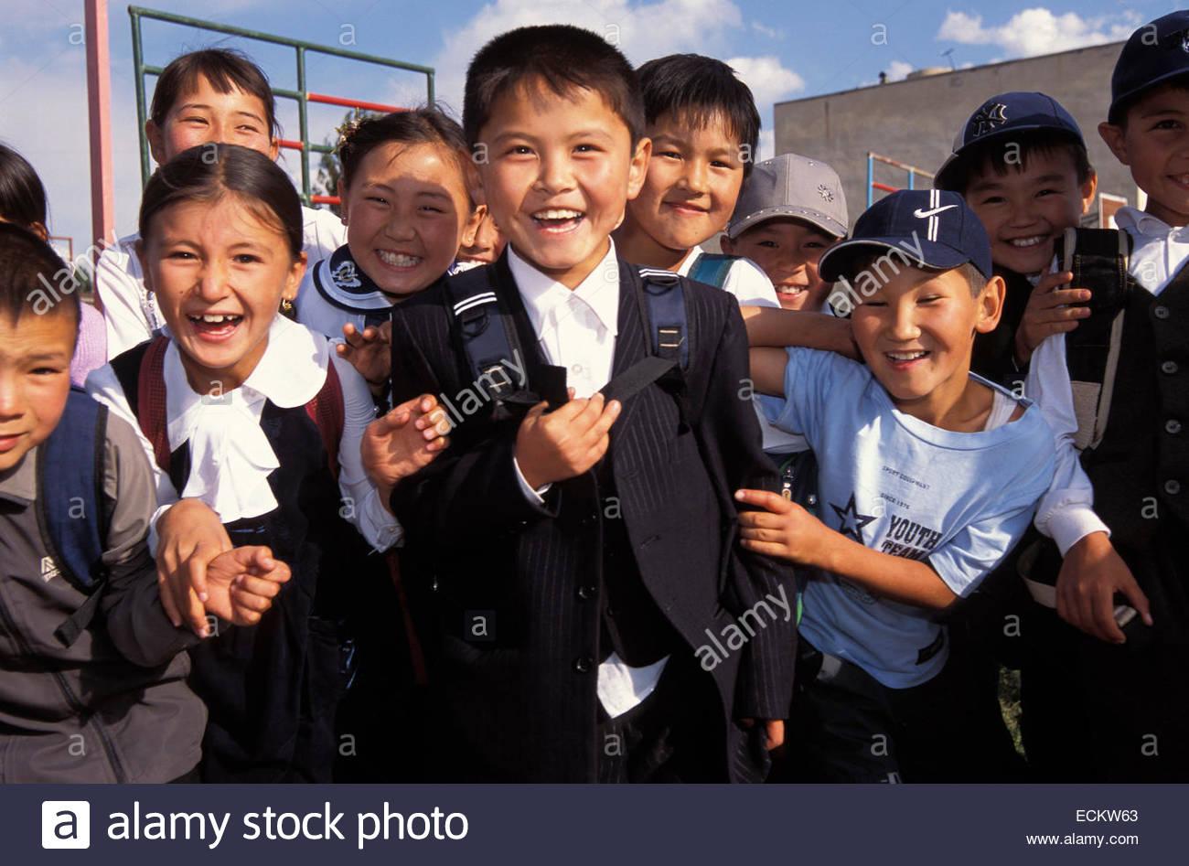 Kyrgyzstan, Schoolboys in Kochkor. Stock Photo