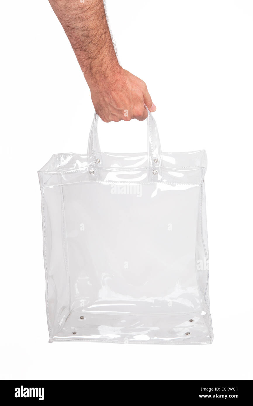 Human hand with transparent plastic bag, isolated on white. - Stock Image