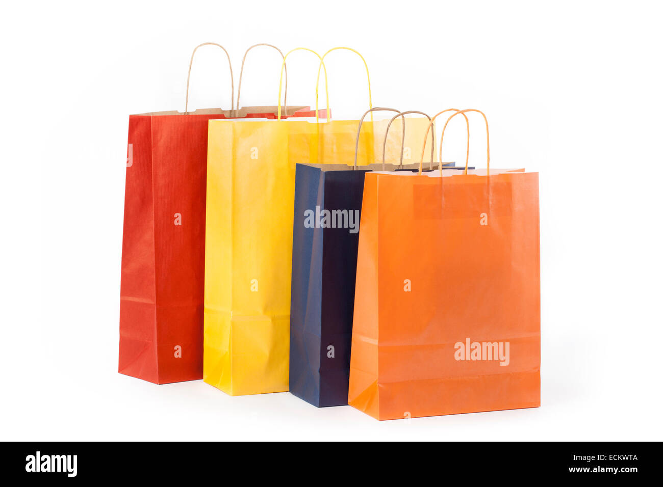 Four paper bags isolated on white background. Stock Photo