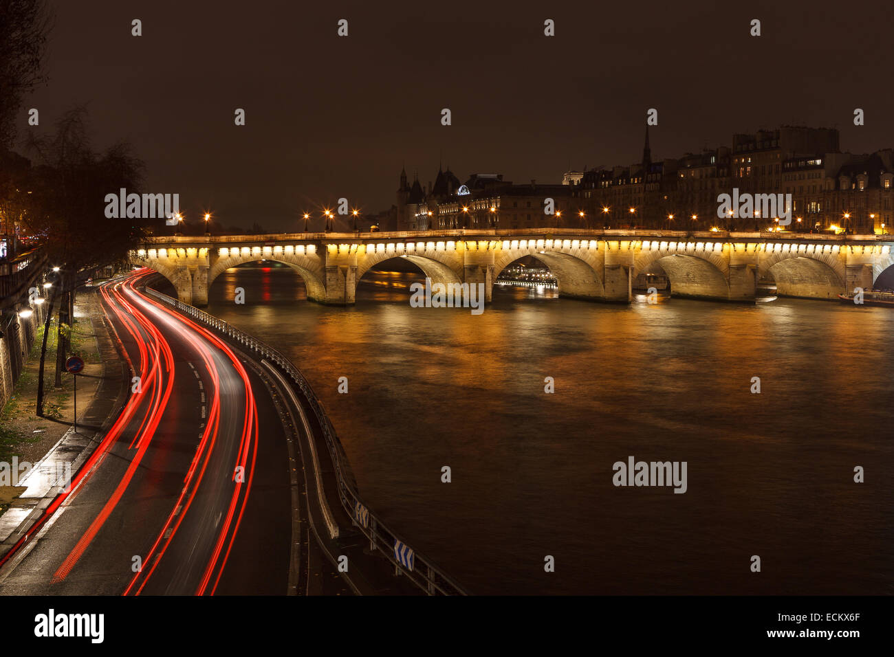 A long exposure shot of Pont Neuf and the Seine River in Paris, France. - Stock Image