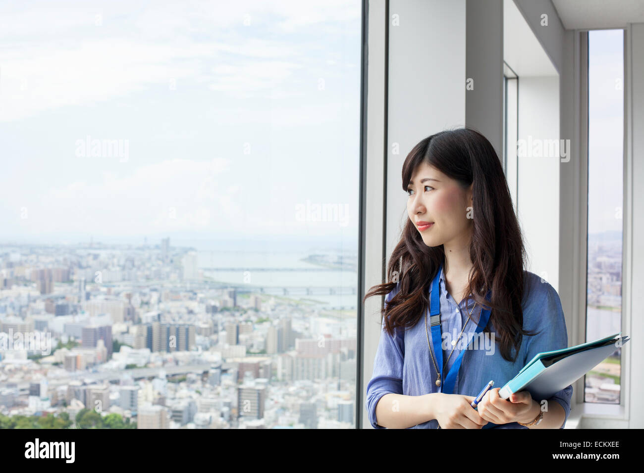 A working woman in an office building. - Stock Image