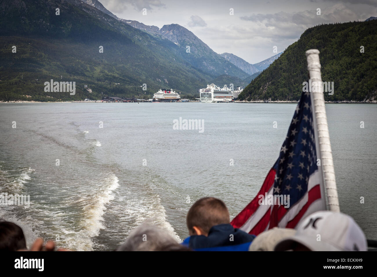 Cruise Ships docked in Skagway, Alaska, USA, North America.  Viewed from a ferry on the Taiya Inlet. - Stock Image