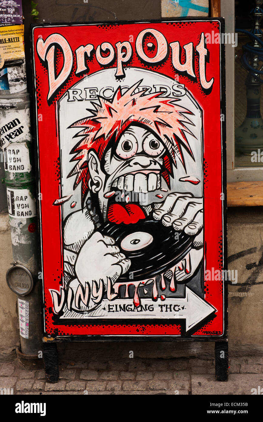 Artwork on sandwich board advertising the Drop Out Records shop. - Stock Image