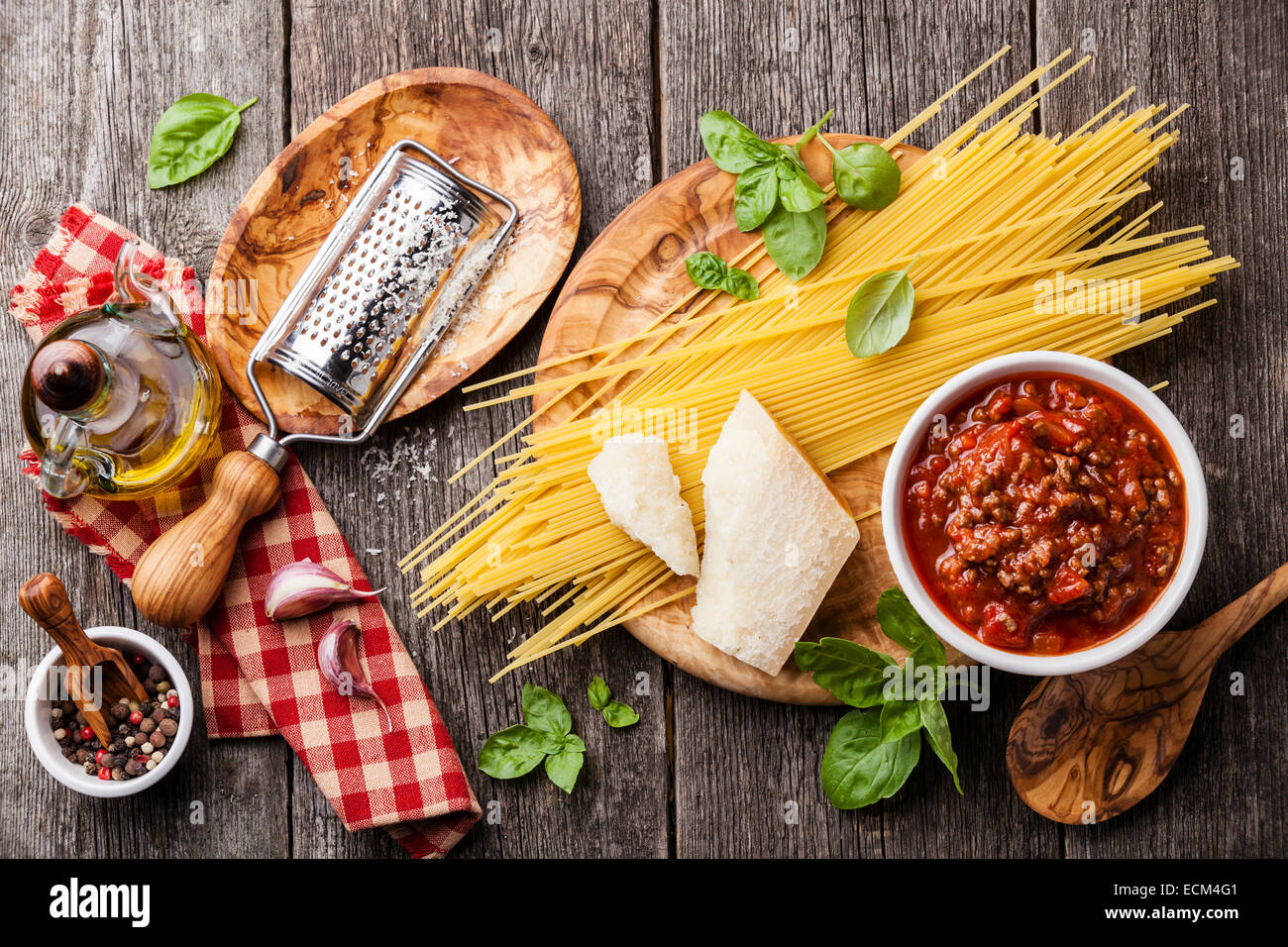 Ingredients for spaghetti bolognese on gray wooden background - Stock Image