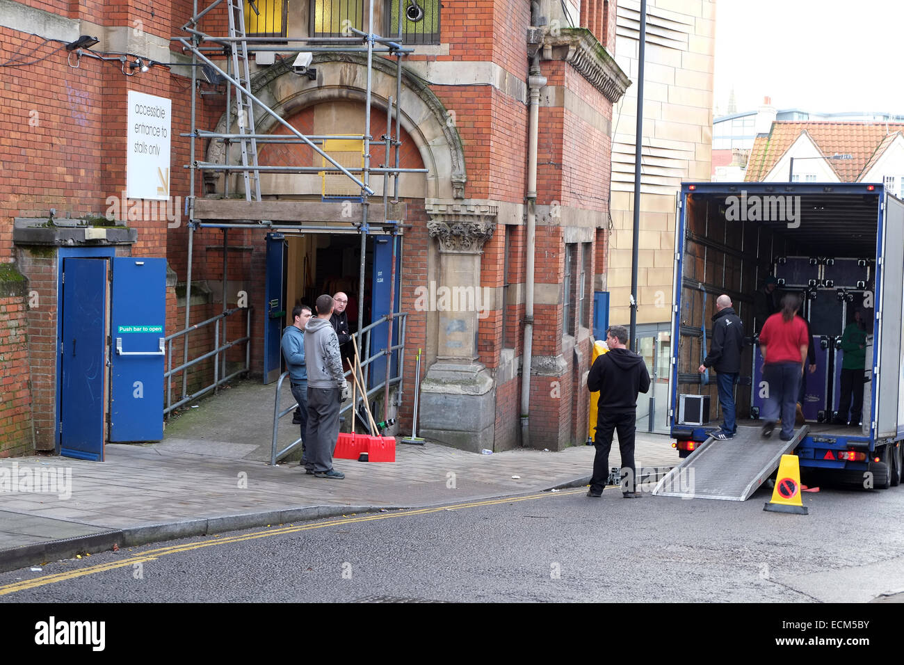 Loading a truck after the performance at the rear of The Colston Hall, from Trenchard Street, in Bristol, 10th December - Stock Image